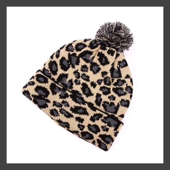 b3accdfa20d pom pom leopard print winter hat toboggan